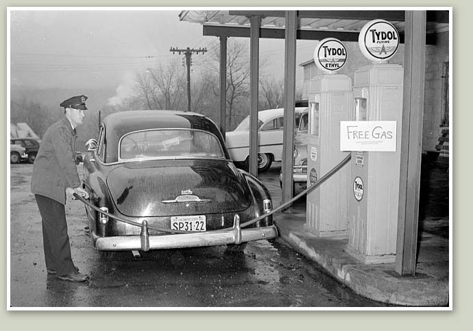 Attached picture pumping_gas_at_higgins_chevrolet-1956.jpg