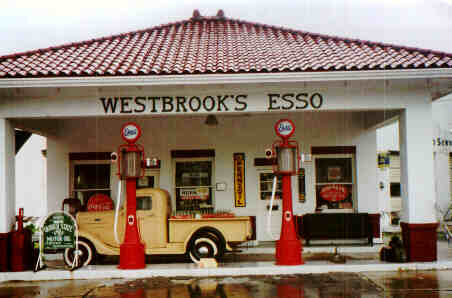 Restored vintage Esso gas station with visible gasoline pumps