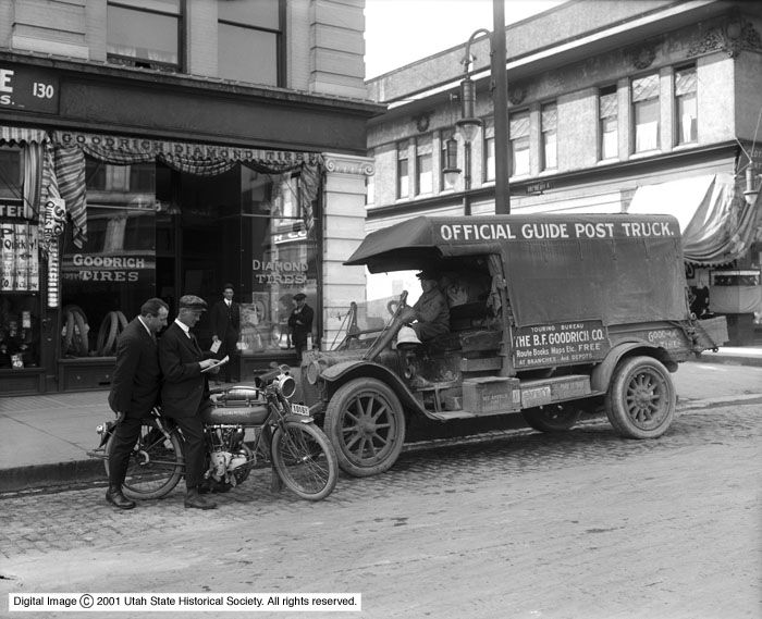 B_F_Goodrich_Rubber_Company_Official_Guide_Post_Truck_in_Front_of_Store (1).jpg